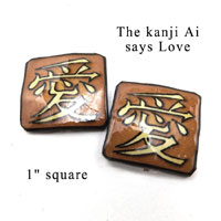 lacquered paper kanji clip on earrings that say Love in Japanese kanji