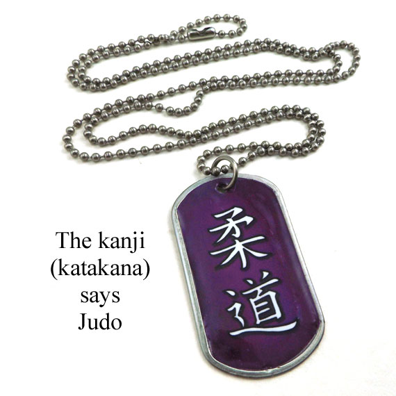 stainless steel and lacquered paper dogtag necklace that says Judo in Japanese katakana