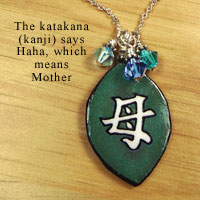 green necklace with Swarovski crystal elements says Mother in Japanese katakana