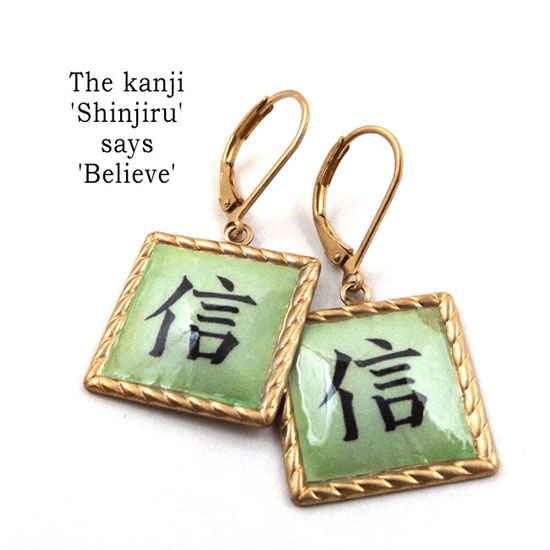 kanji earrings that say Shinjiru, which means Believe.... these are made with brass and lacquered paper