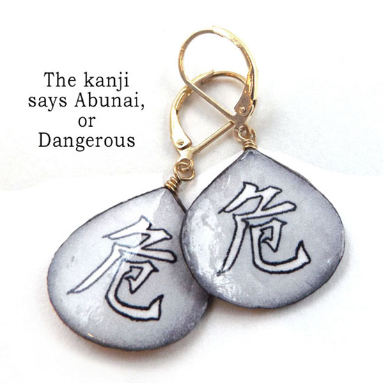 light gray lacquered paper kanji earrings that say Abunai, or Dangerous