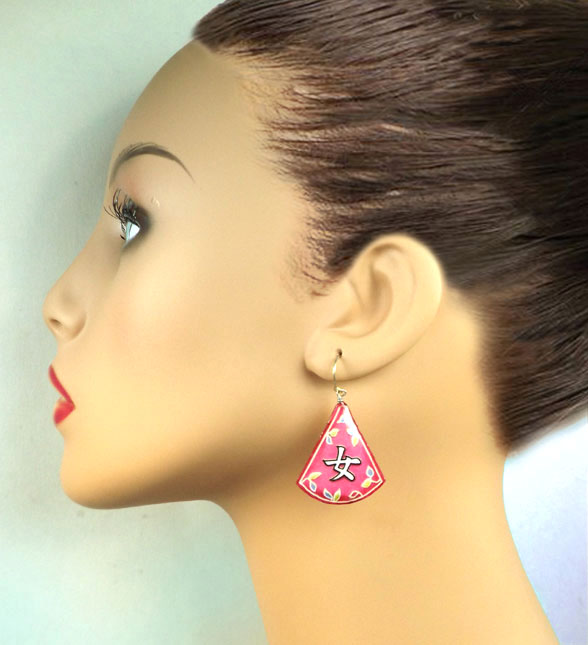lacquered paper earrings that say Onna, or Woman, in Japanese katakana...available at paperjewels.com