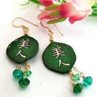 deep green lacquered paper earrings with swarovski crystals and the kanji bijin, which means beautiful woman or hot babe