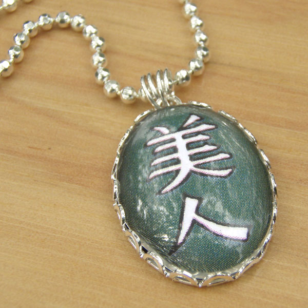 Paper Jewels kanji necklace that says Bijin, or Beautiful Woman