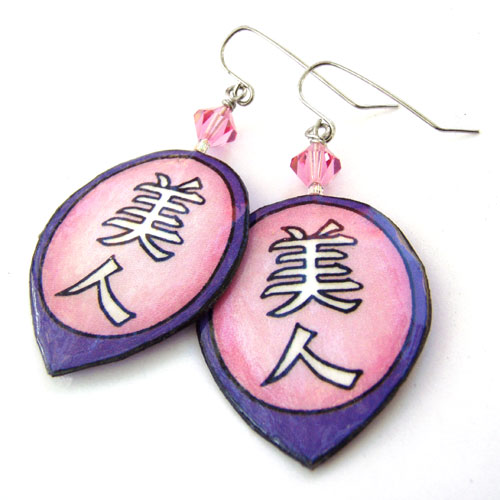 pink and purple lacquered paper earrings with the japanese kanji bijin, or beautiful woman