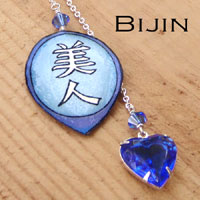kanji necklace with a sapphire vintage glass rhinestone heart jewel and the japanese kanji that says Bijin...with Swarovski crystals