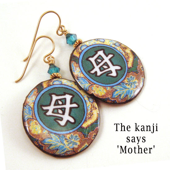 lacquered paper kanji earrings with blue zircon crystals and the Japanese kanji that says Mother