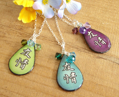 lacquered paper Japanese kanji friendship                  necklace - shown in peridot, turquoise and purple. With Swarovski crystal accents and sterling silver chain