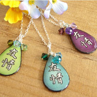 Lacquered paper japanese kanji friendship pendant accented with swarovski crystals