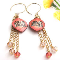 paper earrings with the kanji mesu - female animal, or bitch...shown in coral with Swarovski crystal dangles