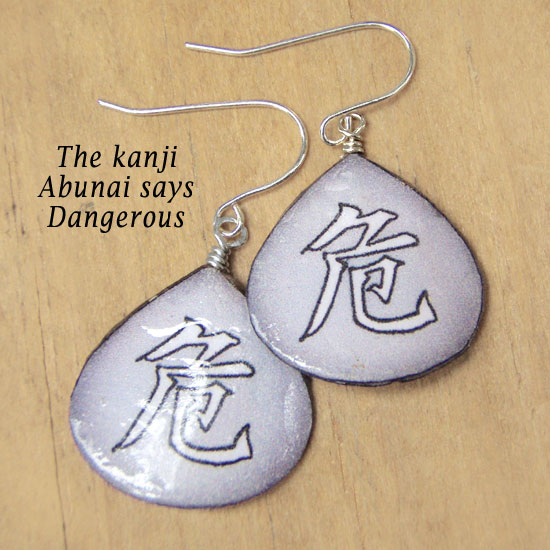 lacquered paper earrings with the Japanese kanji Abunai that says Dangerous