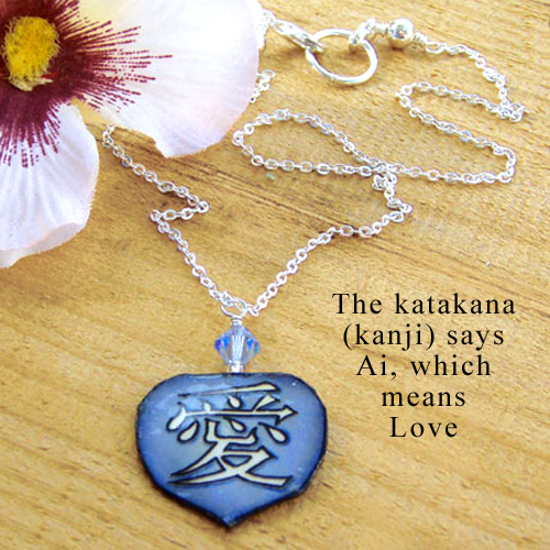 lacquered paper blue necklace with the japanese kanji that says Love