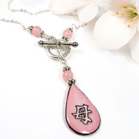 kanji necklace with pink teardrop pendant that says Mother