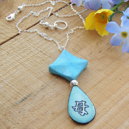 lacquered paper pendant with the japanese kanji that says Mother...with a turquoise howlite diamond pendant bead, and silver plated chain