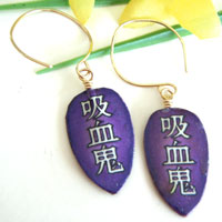 purple paper earrings with the Japanese kanji kyuuketsuki, which means Vampire