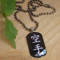 lacquered paper black and white dogtag necklace that says karate