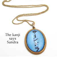 kanji necklace with her name in Japanese - this pendant says Sandra