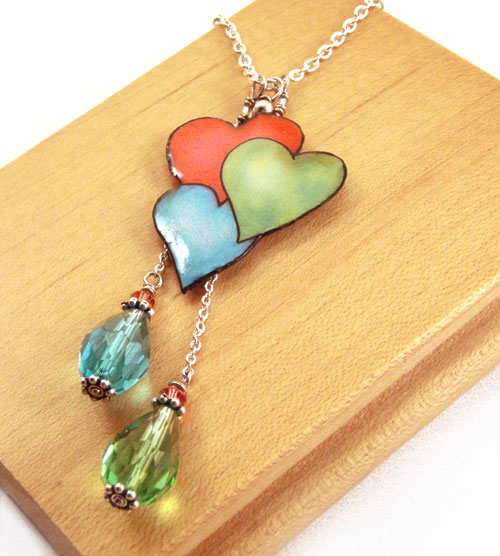 aqua green and coral orange hearts necklace with crystal teardrops