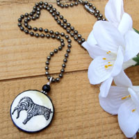 black and white lacquered paper zebra pendant on an antiqued silver plated brass ball chain