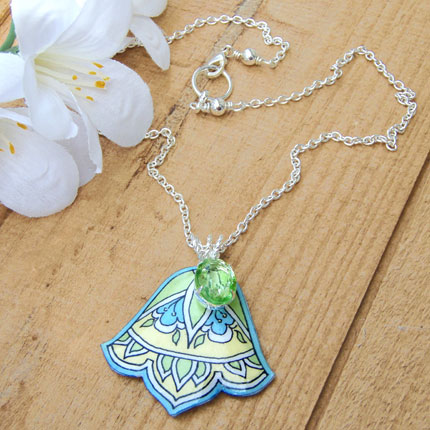 art deco inspired lacquered paper pendant with vintage glass peridot jewel.
