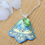 lacquered paper necklace in green, blue and cream with vintage peridot glass jewel