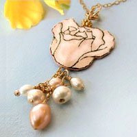 gold necklace with pale cream-peach rose and handwired pearls