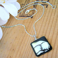 Lacquered paper sleeping cat black and white necklace with silver plated brass chain