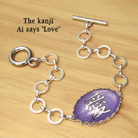 glass and paper silver chain bracelet with the Japanese kanji Love