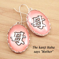 pink oval glass and paper earrings with the Japanese kanji haha, or Mother
