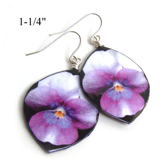 paper earrings are purple pansy flowers on black